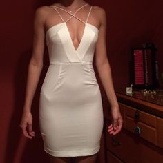 AQ/AQ strappy mini dress in WHITE WILL SELL FOR 65 on M!!! BodyCon dress by AQ/AQ. I never wore it but took off the tags impulsively after I bought it. it is not the exact dress pictured in black however it is the same kinda style by same designer so I put it up for another look Dresses Mini