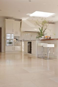 Lucerne limestone in a honed finish offers a sleek modern stone for a contemporary kitchen. From Artisans of Devizes. Marble Floor Kitchen, Kitchen Tiles, Kitchen Flooring, New Kitchen, Kitchen Design, Kitchen Cabinet Colors, Kitchen Colors, Kitchen Interior, Kitchen Decor