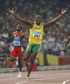 Bolt winning the 200 meters in 19.30 seconds, besting Michael Johnson's 12-year-old record, which many had considered unbreakable. With the win, Bolt became the first man to complete the 100-200 double since Carl Lewis in 1984. He also helped Jamaica's 4x100 relay team set a world record en route to his third gold medal in China.