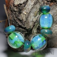 Gorgeous Glowing green orbs Glass bead set in green and by Whitney Lassini, $22.00