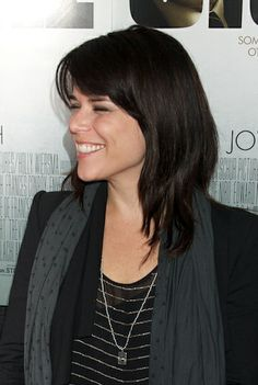 Neve Campbells dark hairstyle with bangs