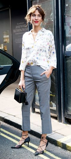Alexa Chung in a white printed button up + checkered trousers + milkmaid braids