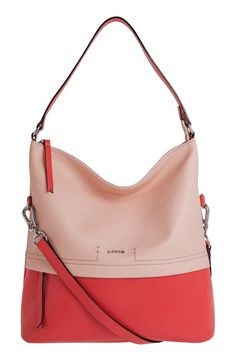 An impeccably designed hobo bag in shades of pink provides enough room for the smartphone and other essentials, while an optional shoulder strap allows hands-free ease during your busy day.