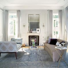 living room - dove grey curtains, gold table, wall molding