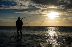 Trying to fish the sun by Victor Marques on 500px