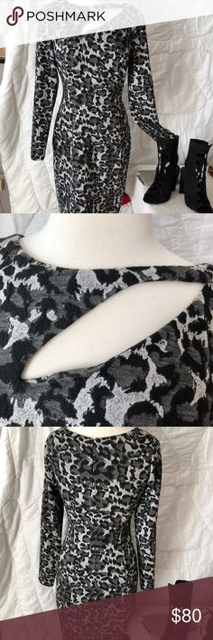 Kay Unger Dress Kay Unger size 8 dress. Black, gray and white abstract animal print lightweight knit. 98% poly and 2% spandex.   Cut-out accent on neckline.  Unlined. Back zip.  32 inches across bust.  36 inches long.  Flawless condition.  I DRY CLEAN BEFORE SHIPPING Kay Unger Dresses
