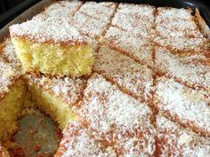 מתכון עוגת סולת תפוזים וקוקוס, עוגת סולת אפויה מושלמת עם מיץ תפוזים וקוקוס בזיגוג סירופ סוכר עם נגיעות לימוניות וקישוט קוקוס טחון - העוגה המושלמת לצד כוס הקפה