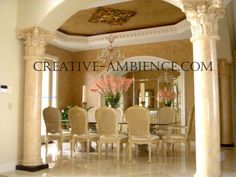Marble finish for  24 columns,  Venetian plaster for dining room walls  and  'aged metallic' faux finish for ceiling.
