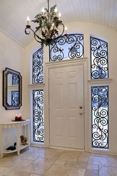Tableaux® Faux Iron decorative grilles provide a personalized transformation to any entry. Home Room Design, Home Interior Design, Interior Decorating, Iron Windows, Iron Doors, Transom Windows, Style At Home, Wrought Iron Decor, Rod Iron Decor