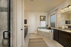 Cross Creek Ranch Model Home Open Daily - 3,593 Sq. Ft. - Master Bathroom - #PerryHomes #trustedbuilder #homebuying #homebuilding #CrossCreekRanch #FulshearTX #KatyISD #KatyHomes #KatyTX #HoustonHomes #openconcept #openfloorplan #familyhome #realestate #RelocatingtoHouston #lakesidecommunity #lakesideliving #stoneexterior #masterbathroom #masterbath #masterretreat #mastersuite #gardentub #bathroomvanities #vanitylighting #bathroomtile