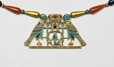"""Pectoral and Necklace of Sithathoryunet with the Name of Senwosret II, (ca. 1887-1878 B.C.). Middle Kingdom, Egypt. Gold, carnelian, lapis lazuli, turquoise, garnet (pectoral) Gold, carnelian, lapis lazuli, turquoise, green feldspar (necklace). The Metropolitan Museum of Art, New York. Purchase, Rogers Fund and Henry Walters Gift, 1916 (16.1.3a, b)