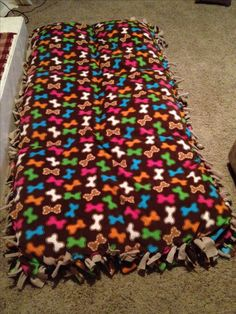DIY dog bed for less! I'm too tight to spend $60 for a large dog bed, especially needing two for our dogs so I made one for both and a lot less! I took 6 pillows and stitched them together, covered them with 3 yards of fleece fabric (one a printed fabric and just a plain fabric- 6 yards total) and cut to size. The size of this dog bed is huge, about the length and width of a standard sofa's cushions.