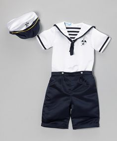 Seafaring sweeties can set sail in style in this nautical-inspired outfit. The satin shorts and embellished shirt create a classic charming look with an embroidered hat to top it off.