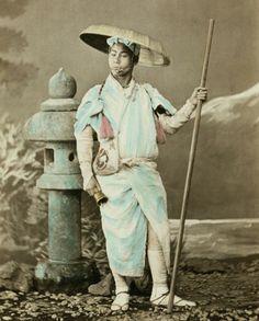 Studio portrait of a Buddhist pilgrim. Hand-colored photo, 1870's, Japan, by photographer Felice Beato