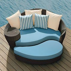 23 best Patio and pool furniture for year round outdoor living     Blue  cream  and brown resin wicker daybed and ottaman  Outdoor pool  furnitureOutdoor