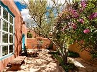 This truly lovely Santa Fe home is newly renovated, offering all modern amenities, while maintaining the charm of the traditional style Santa Fe homes. Guests return to this home year after year for it's comfort and unique design. The entire home boasts vaulted ceilings with traditional viga beams, and large windows to let in the sunshine.