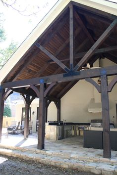 trying to decide what to do with the beams on our porches. I'm thinking stain them dark. Cheap and easy!