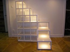 Bokhylla stairs made of steel framework and MDF board, these shelves from Compact-Living.com double up as stairs for ascension to a loft bed. Unfortunately the site is in Swedish