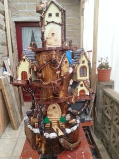Hi this is my first attempt at a fairy house garden feature for my grandaughters it is not quite finished yet as it has to be in place before the final touches are made i cant get it into my car with the top house screwed on so cant complete until then.