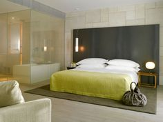 Mamilla Hotel in Jerusalem.  Love the neon bedspread against the gray.