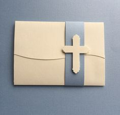 elegant hand die cut invitation for first holy communion or confirmation. we customize for a girl or boy, flourish accents/colors of your choosing.   invitation is featured a simple, elegant cross, and with blue band, which can be changed to any color of choice.