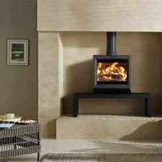 Combustion fireplace built in to the wall on stand perfect for dining room.