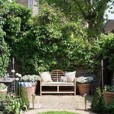 Country garden with outdoor seating and floral cushions