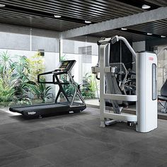 This modern home gymnasium features porcelain Charcoal Grey Slate floor tiles for a modern feel that's also low maintenance and hard wearing. Grey Slate Floor Tiles, Slate Effect Tiles, Large Floor Tiles, Slate Flooring, Tile Floor, Flooring Ideas, Interior And Exterior, Charcoal, Porcelain Tiles
