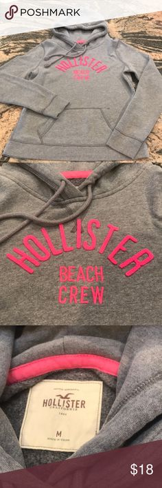 Sweatshirt -Hollister Hollister Hoodie. He agreed gray color with pink logo. In great condition. Super soft fabric. No snags or stains. Smoke & pet home. 60/40 cotton/polyester blend. Hollister Jackets & Coats