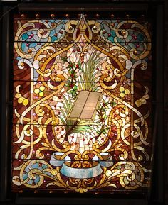 A large Antique American Stained and Jeweled Glass Window.
