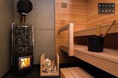 Black bathroom, concrete and wood in the sauna.