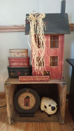 Primitive Saltbox - Love this display and especially the little sign that says Live Life Joyfully #Primitivecountrydecorating