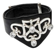 Bold jewelry. Designer romantic pendant on costume leather bracelet. In vogue jewelry.