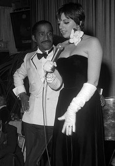 Liza Minelli & Sammy Davis Jr.  Who other than Liza Minelli could share the stage with Sammy Davis Jr. at their wedding? That's exactly what the entertainer did at her 1986 affair