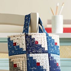 """You can create this scrappy Log Cabin tote from 5"""" squares in a weekend's  time!Fabrics are from the Vintage Shirting & Dress Prints 1880–1910  collection by Barbara J. Eikmeier for Paintbrush Studio [1].   [1] http://fabri-quilt.com"""