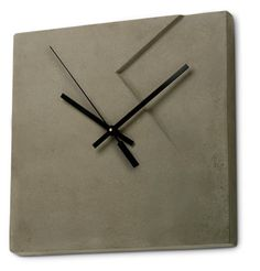 Concrete wall clock by the amazing concrete designers at Marit Meisler Cemment
