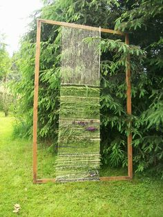 DIY outdoor loom. would make a wonderful screen of dividing fencing in your garden