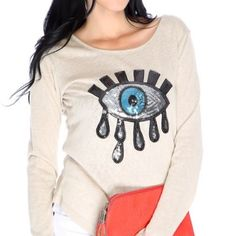 Sequined evil eye top- beige Brand new with tags. Burnout knit top, asymmetrical hem with sequined eye patch. Size M/L. 100% polyester. Tops Tees - Long Sleeve