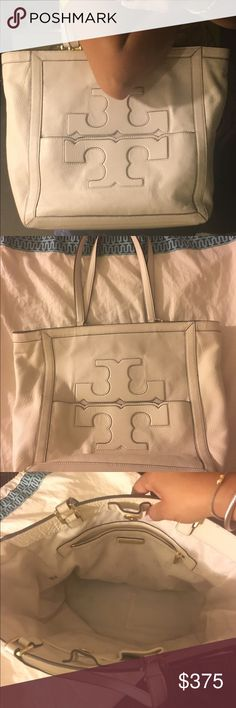 Authentic Tory Burch XL Tote Pre-Loved! Authentic TB off white Supple Pebbled Double-T logo. Multiple pockets. Magnetic closure, visible signs of wear on the back due to the jeans. But professional clean will take care of it. Other than that excellent conditions. Kept on dust bag. Smoke free home. Tory Burch Bags Totes