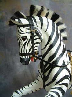 Legends create more unusual horses, both as rocking horses and free-standing horse sculptures. Painted or left in natural wood to enhance the beauty of the carving.    These include carousel and racer rocking horses,a unicorn,zebras and free-standing, life-size carousel horses.