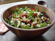 Chickpea Feta Salad over Greens recipe from Trisha Yearwood via Food Network-pinning for lemon salad dressing