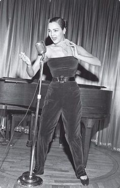 """Dorothy Dandridge wearing a velvet jumpsuit while performing at New York City's La Vie en Rose, circa 1952. """"""""Dorothy Dandridge is the most strikingly good looking Negro singer to come along since Lena Horne. But 'everyone' told her that she still..."""