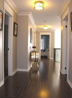 Gray walls, white trim, dark floors
