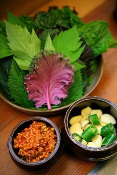 Ssam(쌈) is the way to eat rice and condiments wrapped in leaves of lettuce, cabbage, sesame, or other greens. It usually served with soy bean paste sauce. People like to add a garlic and pepper to Ssam.