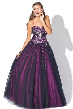 Gorgeous ballgown! This dramatic blackberry gown is stunning with a heavily beaded stone corset.