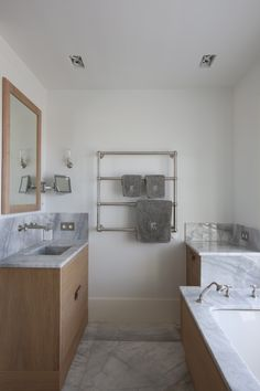 How to create style in a bathroom using traditional taps in a modern setting.