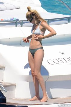 Pin for Later: Model Doutzen Kroes Packs On the PDA With Her Husband While Relaxing on a Yacht