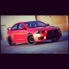 Mitsubishi Lancer Evo  Same car that I have right now. But my car is blue. Love this car. :)