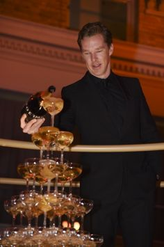 BIFA's 12/7/2014. Not only is he gorgeous and talented, he knows precisely how to properly pour a champagne tower. <3