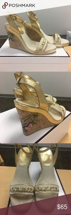 """Coach Ellette Wedge Platform gold sandals Coach Ellette Wedge Platform gold sandals. Style: A3433 Ellette LX CNV/MET K;    Ribbon threaded gold chain at toe accent;natural tone colored insole and cross toe; size 7.5M;  Heel: 4""""; MSRP $158.   In almost brand new condition. Used a couple of times. There is a minor scuff mark at the back top of the right heel. See photo. Coach Shoes Platforms"""